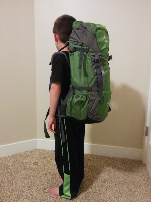 Six-year old wearing a Deuter Fox 40 backpack